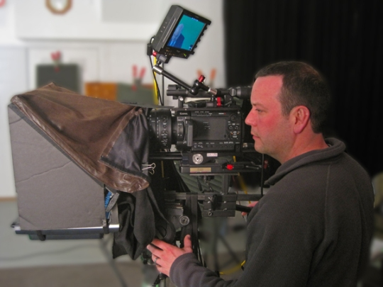 st lous video production camera operator with teleprompter attached