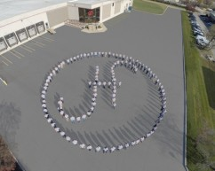 employees as logo with drone imagery