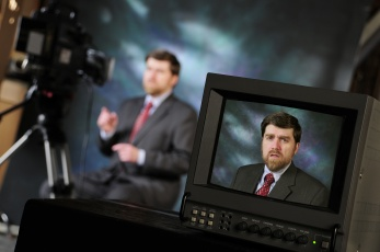 Monitor in production on location showing spokesperson for ADA talking to teleprompter on video camera