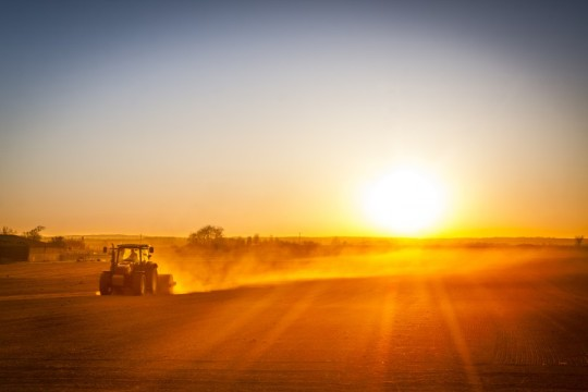 The American Farmer prepares his field as the new day begins!